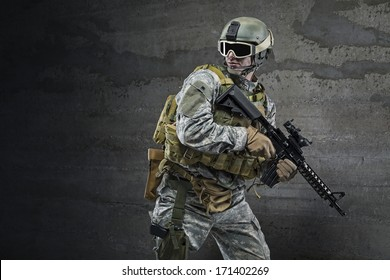 Soldier with rifle and mask