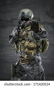 Soldier with rifle and mask in alt gesture