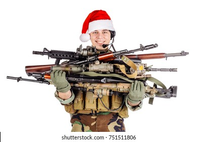soldier with rifle wearing Santa claus cup and holding rifles isolated on white background