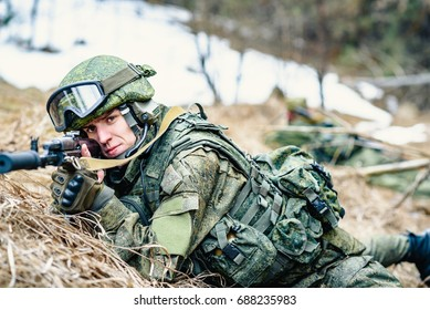 A soldier of the Russian army with an automatic sight, examines the terrain