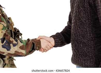 Soldier shaking hands with civil man at studio white background