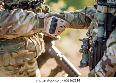 Soldier shaking hands on outdoor background. People and military concept