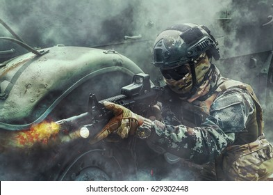 Soldier Shoot gun M16 By the smoke Attached to a military vehicle.