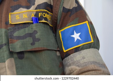 A soldier from the Somali National Armed Forces (SNA), with the Somali flag on the sleeve of his camouflaged uniform, in Mogadishu, Somalia.