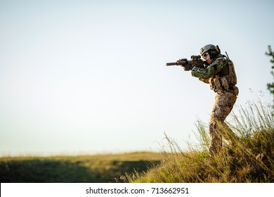 soldier of special forces in action pointing target and giving attack direction.