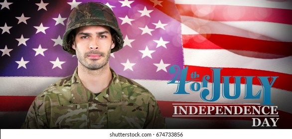 Soldier standing against white background against close-up of american flag