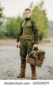 soldier standing and holding their equipment