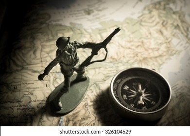 Soldier toys with compass on map