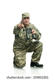 Soldier in uniform with binoculars