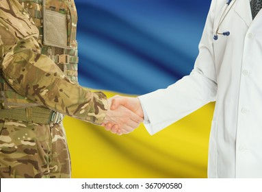 Soldier in uniform and doctor shaking hands with national flag on background - Ukraine