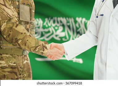 Soldier in uniform and doctor shaking hands with national flag on background - Saudi Arabia