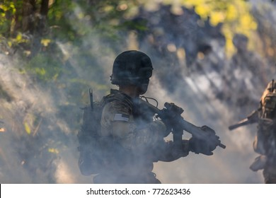 Soldier walking in a smoky battlefield, Green Beret soldier in the jungle, Army soldier attacking in the smoke.
