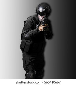 Soldier wearing black suit with a G36K isolated