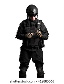 Soldier wearing black suit with knife isolated