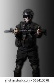 Soldier wearing black suit with a m4 doing victory gesture isola