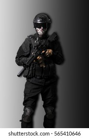Soldier wearing black suit with a m4 isolated