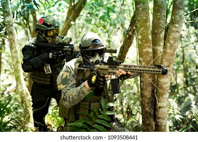Soldiers in action in a game of airsoft with his weapon