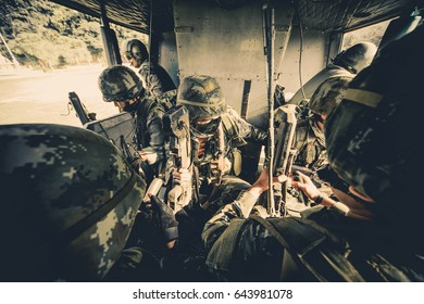 Soldiers boarding a military helicopter