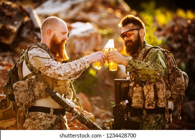 Soldiers Celebrating victory. Soldiers drink beer.