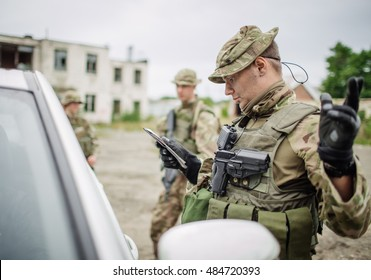 soldiers at the checkpoint stopped a car to check documents