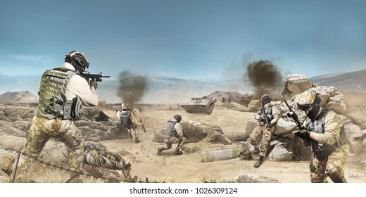 Soldiers fighting on desert scene. Photo of a soldiers fighting and atacking on a desert battlefied background.