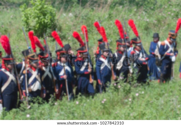 soldiers of the French army of Napoleon 1812 an abstract background of a spot with bokeh effect specially without sharpness