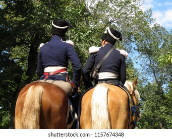 Soldiers of the French cavalry of Napoleon's army riding in the forest. Horsemen during historical reconstruction of the Napoleonic wars of the 19th century