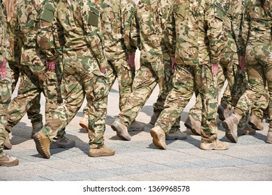 Soldiers marching on the street