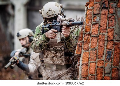 soldiers or private military contractors aiming with rifle. war, army, weapon, technology and people concept.