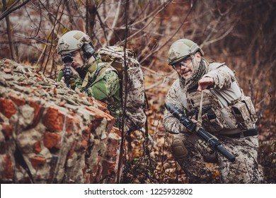 soldiers or private military contractors holding black gun. war, army, weapon, technology and people concept.