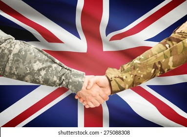 Soldiers shaking hands with flag on background - United Kingdom