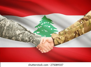 Soldiers shaking hands with flag on background - Lebanon