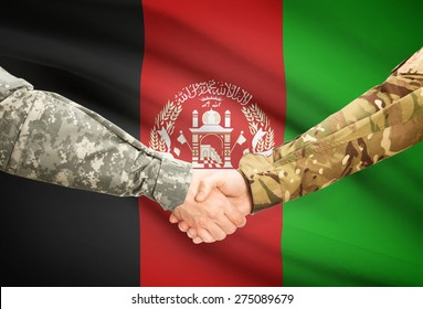 Soldiers shaking hands with flag on background - Afghanistan