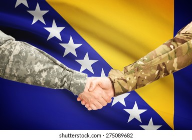 Soldiers shaking hands with flag on background - Bosnia and Herzegovina