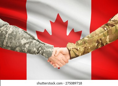 Soldiers shaking hands with flag on background - Canada