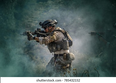 Soldiers in Special Forces, Army soldier in Protective Combat Uniform holding Special Operations Forces Combat Assault Rifle.