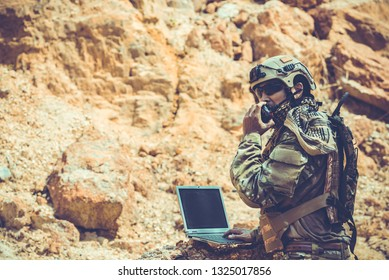 Soldiers of special forces on wars at the desert,Thailand people,Army soldier use laptop for see map with satellite,Using Radio For Communication During Military Operation