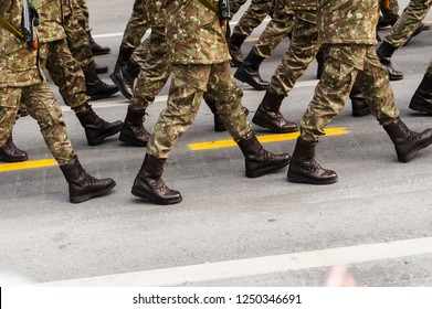 Soldiers squad seen from the waist down marching during the National Day parade in Bucharest.