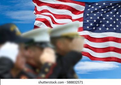Soldiers and veteran saluting