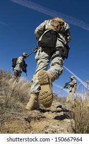Soldiers walking in field