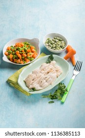 sole fish with carrot, green beans and broad beans salad