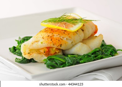 Sole stuffed with crab on a bed of spinach.