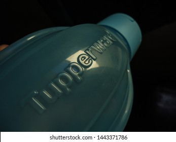 Soledade, Paraíba/Brazil - July 4, 2019: The approximate image of a bottle of water in the blue color of the Tupperware brand. Tupperware is an American brand specializing in plastic products.