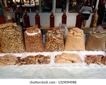 Soledade, Paraíba/Brazil - March 4, 2019: Typical market stall of the Brazilian Northeast with sacks of chestnut and bottles of honey