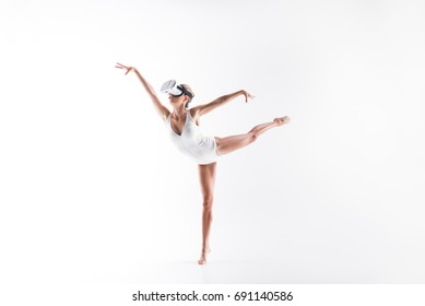 Solemn youthful woman gymnast performing sport exercise with goggles