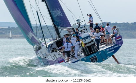 """The Solent, Hampshire, UK; 7th August 2018; Rear View of Volvo Ocean 65 Yacht """"Team AkzoNobel"""" at Sea With Crew Members on Deck"""