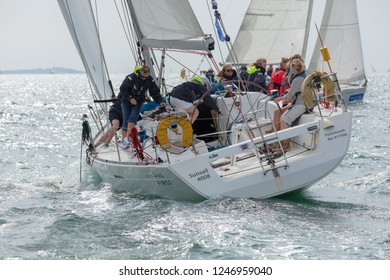 The Solent, Hampshire, UK; 7th August 2018; Sailors on a Yacht Participating in a Race at the Cowes Week Regatta