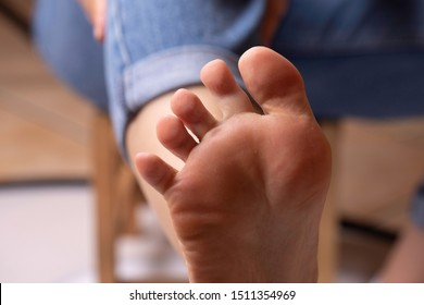 Soles of feet, the bottom of the foot of a young woman in close