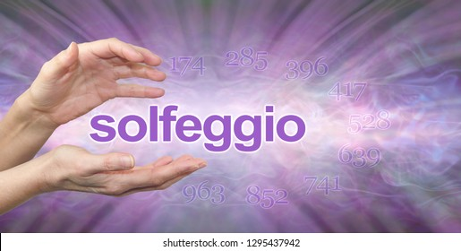 Solfeggio Hertz Frequencies banner - female hands with the word SOLFEGGIO floating between surrounded by the 9 healing frequencies on a purple lilac radiating sound wave background