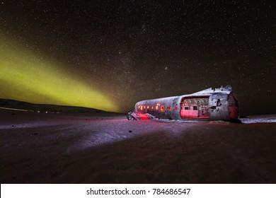 Solheimasandur plane wreck with active norhtern lights, Iceland, Europe.